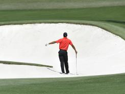 Tiger Woods hits another errant shot, this one following one that went into the fairway bunker on 18.