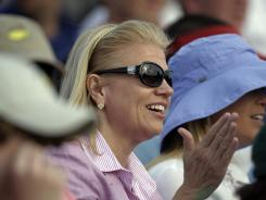 IBM CEO Virginia Rometty watches the final round of the Masters golf tournament from the gallery on the 18th green.
