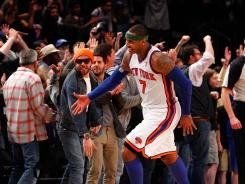 Carmelo Anthony reacts with fans after the Knicks beat the Bulls in overtime at Madison Square Garden.