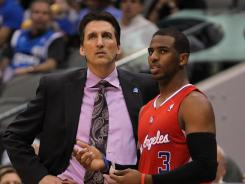 Vinny Del Negro, left, and star guard Chris Paul visit during a game against the Mavericks earlier this month. Del Negro said his job was never in jeopardy.