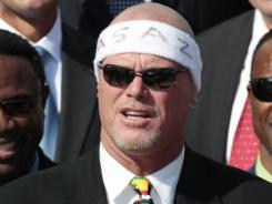 Former Chicago Bears quarterback Jim McMahon is being sued an attempt to recover $104 million.