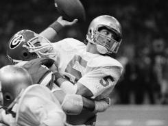 Former Notre Dame Quarterback Blair Kiel is hit by Georgia's Pat McShea during the Sugar Bowl on Jan. 2, 1981 in New Orleans. Kiel, the former Notre Dame quarterback and punter who played for Tampa Bay, Indianapolis and Green Bay in the NFL, died Sunday, April 8, 2012.