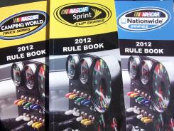Elusive NASCAR rulebooks, from left, for the Camping World Truck, Sprint Cup and Nationwide series.