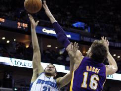 Lakers forward Pau Gasol goes for a block of a Greivis Vasquez layup attempt Monday. Gasol had 25 points to lead the Lakers to victory, despite missing Kobe Bryant.