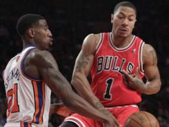 Chicago Bulls guard Derrick Rose, right, came back for one game, Sunday vs. Iman Shumpert, left, and the New York Knicks, but could be out again with an injury.