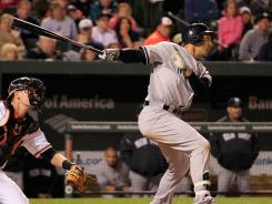New York's Raul Ibanez follows his game-winning RBI double in the Yankees' 5-4 win over the Baltimore Orioles on Tuesday in 12 innings at Baltimore.