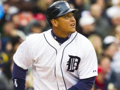 Tigers third baseman Miguel Cabrera hits a double to start a three-run rally in the eighth inning.