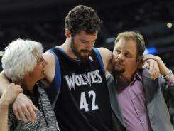 Minnesota Timberwolves forward Kevin Love is helped from the court after suffering a mild concussion during the first half against the Denver Nuggets on Wednesday.