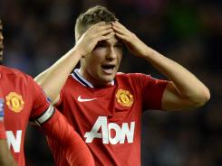 Manchester United's Tom Cleverley reacts after falling to Wigan in an English Premier League match at DW Stadium in Wigan, England.