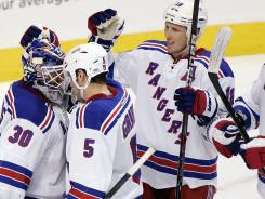 New York Rangers goalie Henrik Lundqvist is congratulated by teammates after a recent win against the Flyers.