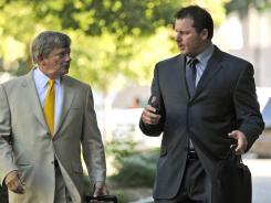 In July:  Roger Clemens, right, and attorney Rusty Hardin outside federal court. Clemens' first trial was halted when banned evidence was introduced.