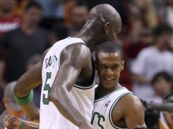 Boston forward Kevin Garnett, left, and guard Rajon Rondo celebrate after the Celtics defeated the Miami Heat 115-107 on Tuesday.