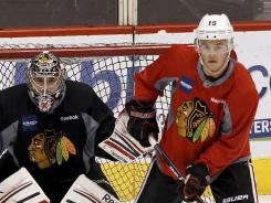 Jonathan Toews practices in front of goalie Corey Crawford on Wednesday.