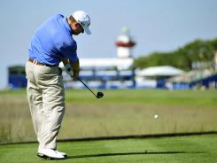 Chad Campbell launches his tee shot on the 18th tee during the first round of the RBC Heritage.