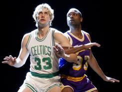 Tug Coker (left), who was a walk-on basketball player for William and Mary, portrays Larry Bird in the play Magic/Bird. Kevin Daniels plays Magic Johnson.