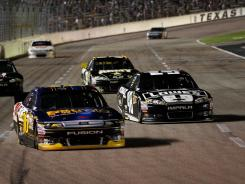 "Jimmie Johnson, right, trails leader Greg Biffle in Saturday night's race at Texas Motor Speedway. That is how they would finish. ""Second sucks,"" Johnson said."