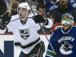 The Kings' Jarret Stoll celebrates a goal as Canucks goalie Roberto Luongo looks skyward.