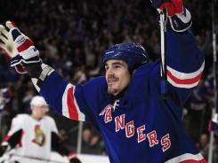 The New York Rangers' Brian Boyle celebrates after scoring a goal during the second period.