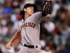 Bumgarner, Giants beat Moyer, Rockies 4-2