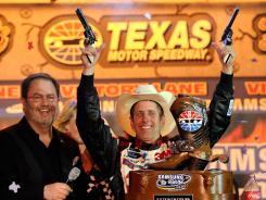 Greg Biffle fires Turnbull pistols in victory lane (as Texas Motor Speedway President Eddie Gossage looks on) after winning the Samsung Mobile 500.