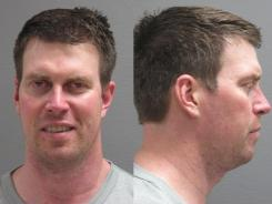 Former NFL quarterback Ryan Leaf, shown here in a police booking photo on April 2, has been charged with four felonies.