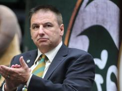 Larry Eustachy applauds Colorado State athletic director Jack Graham during Eustachy's introduction as CSU's men's basketball coach.