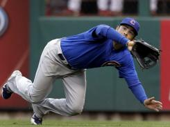 Cubs right fielder David DeJesus dives to catch a ball hit by Cardinals outfielder Matt Holliday to end the sixth inning of their game on Friday in St. Louis.