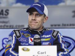 """I'm not going to bash her,"" Carl Edwards, pictured Friday at a news conference at Texas Motor Speedway, said of ex-girlfriend Amanda Beard."