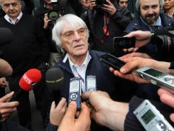Formula One supremo Bernie Ecclestone (C) speaks to the media after meeting with Formula One team officials to discuss the Bahrain F1 race at the Shanghai International Circuit on April 13. Ecclestone earlier said that he was unable to force teams to participate in this month's Bahrain Grand Prix following a fresh outbreak of violence in the Gulf state. Formula One teams are reportedly reluctant to race in Bahrain this season amid ongoing concerns over security in the country. Formula One announced Thursday that the Bahrain Grand Prix will go ahead as planned, despite these concerns.