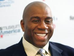 Magic Johnson is part of a group that has agreed to buy the Dodgers for $2 billion from owner Frank McCourt.