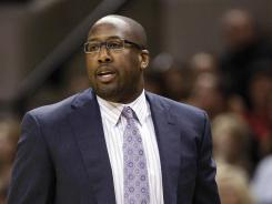 Los Angeles Lakers head coach Mike Brown left before the start of his team's game against the Nuggets on Friday night.