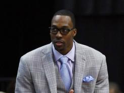 The Orlando Magic's Dwight Howard was diagnosed by a doctor in Los Angeles with a herniated disk in his lower back on Friday.