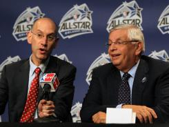 NBA commissioner David Stern, right, and deputy commissioner Adam Silver address the media at the Amway Center in Orlando during the NBA All-Star game.