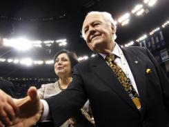 New Orleans Saints owner Tom Benson has agreed to buy the New Orleans Hornets from the NBA.