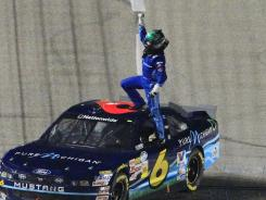 Ricky Stenhouse Jr. stands atop his car after winning the O'Reilly Auto Parts 300.