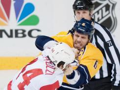 Nashville Predators defenseman Shea Weber and Detroit Red Wings right wing Todd Bertuzzi fight during the first period Friday.