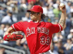 C.J. Wilson allowed one run in six innings for his first career win over the Yankees.