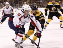 Capitals center Nicklas Backstrom, left, here handling the puck against the Bruins during the third period in Saturday's Game 2, scored the game-winning goal early in the second overtime to lift Washington past Boston.