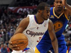 Chris Paul (left) contributed 28 points in the Clippers' 112-104 victory over the Warriors. After picking up wins in 11 of their last 13 games, the Clippers are now only one game behind the Lakers for sole possession of the Pacific Division lead.