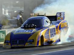 Ron Capps performs a burnout Friday following his No. 1 qualifying effort in Funny Car at zMax Dragway.