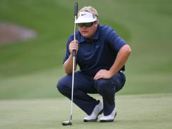 Carl Pettersson lines up his par putt on the 11th hole during Saturday's third round of the RBC Heritage. Five consecutive birdies on the front nine vaulted him to the lead.