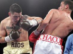 Brandon Rios, left, seemed to be outworked by Richard Abril during most of their fight Saturday, but Rios won a 12-round split decision.