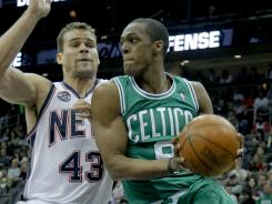 Boston Celtics point guard Rajon Rondo (9) drives to the basket against New Jersey Nets power forward Kris Humphries (43). The Celtics, who beat the Nets 94-82, have won 10 of their last 13 games.