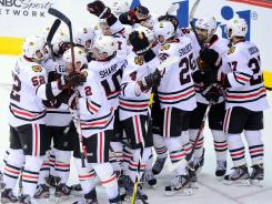 The Blackhawks celebrate after beating the Coyotes 4-3 in overtime in Game 2 of their playoff series. Bryan Bickell scored the game-winning goal.