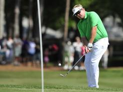 Carl Pettersson of Sweden chips onto the ninth green during the final round of the RBC Heritage.