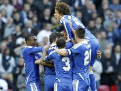 Chelsea celebrates Didier Drogba's 43rd-minute tally that propelled the Blues to a 5-1 win over Tottenham.