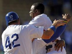 Dee Gordon celebrates his game-winning RBI that moved the Dodgers to a league-best 9-1.