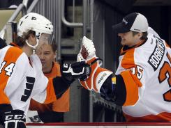 Flyers rookie Sean Couturier celebrates his hat trick goal against the Penguins Friday.