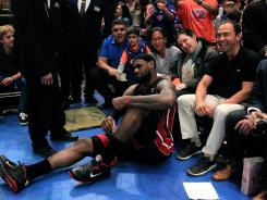 The Miami Heat got a scare Sunday when LeBron James seemed to have hurt an ankle vs. the New York Knicks. But James got back up to play and the Heat went on to win in New York.