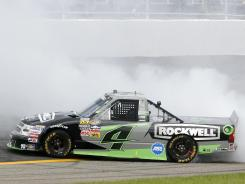 Kasey Kahne does a burnout Sunday after winning the NASCAR Truck Series auto race at Rockingham Speedway in Rockingham, N.C.